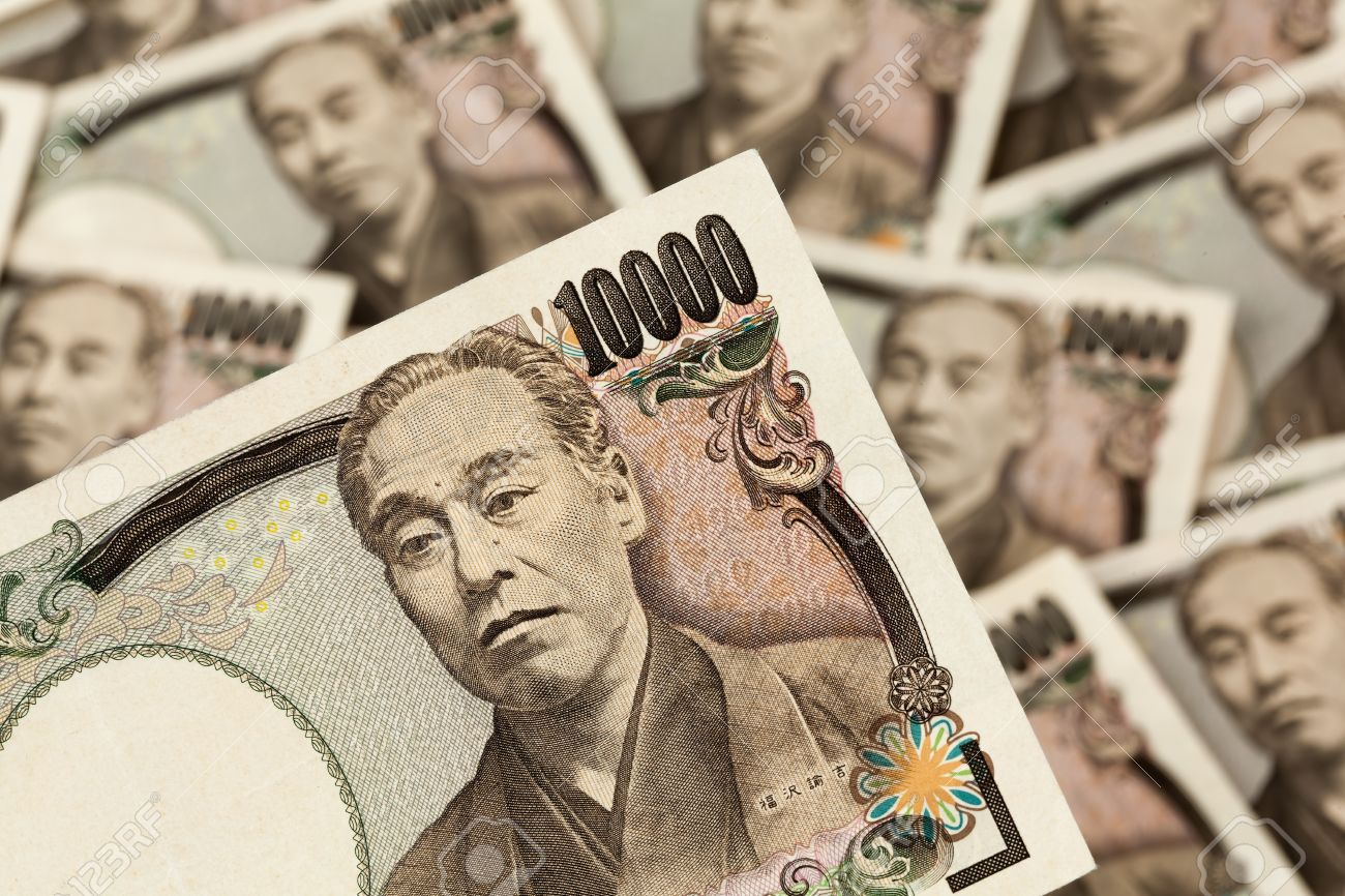 8408633-Japanese-yen-notes-Notes-from-Japan-Close-up-Stock-Photo