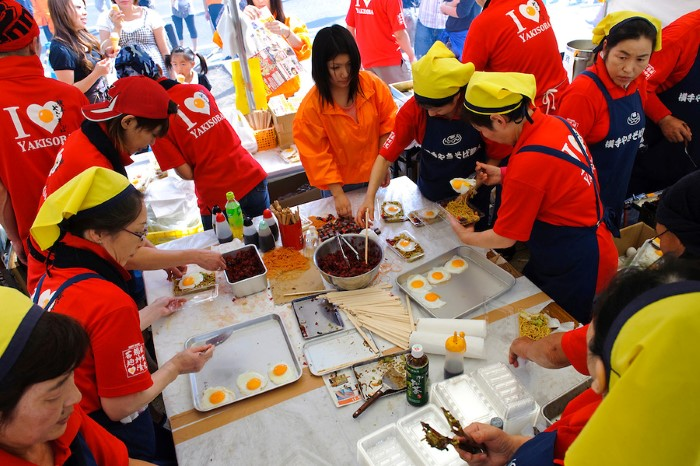 "Making ""Yakisoba"" fried noodles, a Yokote specialty. B1 Grand Prix, Yokote, Akita Pref, Japan, September 19 2009. The B1 Grand Prix is a competition for inexpensive and tasty regional dishes from around Japan. The B stands for ""b-class gourmet"". In 2009 it was held in the northern Japan city of Yokote."